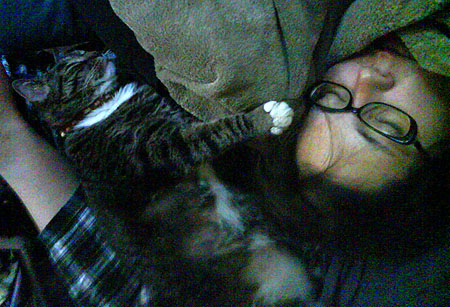 In this picture, leg of hubby (in plaid), Jiji and Sarah (Both asleep)