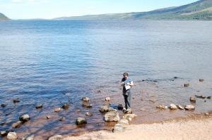 Sarah sock knitting in Loch Ness