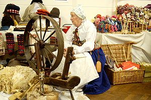 A lady in period dress and wheel looking REALLY uncomfortable the entire time I saw her