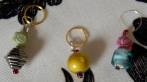 Three little stitch markers sittin' in a row