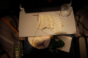 Mile-high lace knitting.  Note the empty scotch glass!